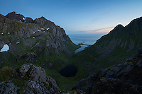 Twilight view over hidden mountain valley, Moskenesøy, Lofoten Islands, Norway