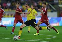 Fussball Bundesliga Saison 2011/2012 1. Spieltag Borussia Dortmund - Hamburger SV V.l.: Kevin GROSSKREUTZ (BVB) erzielt gegen Dennis DIEKMEIER (HSV) das erste Tor der Bundesligasaison 2011/2012.