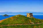 Doyden Castle, Cornwall. <br /> Doyden Castle, situated an hour's walk from Port Quin on a cliff overlooking Lundy Bay, was built in about 1830 by local hedonist Samuel Symons to entertain friends to nights of feasting, drinking and gambling. Today it has been converted into accommodations.