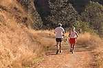 Couple running with their dog on the Stagecoach Trail. A old stage road from Auburn to Foresthill.