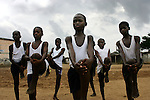 Ivorian boys train at the Olympic Sport Abobo club in the Abobo neighborhood of Abidjan, Ivory Coast February 18, 2006. Motivated by the success of the national team, and Ivorian footballers in European leagues, Ivorian boys and their parents often view football as their only chance to escape poverty within their communities.