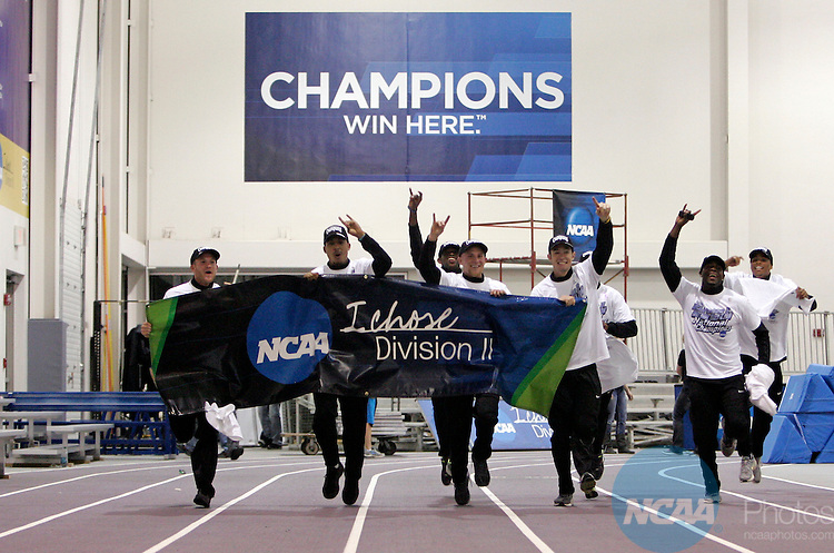 "10 MAR 2012:  The Grand Canyon University men's track team celebrates winning the national title by carrying the NCAA ""I Chose Division II"" sign around the track during the Division II Men's and Women's Indoor Track and Field Championship held at Myers Fieldhouse on the campus of Minnesota State University, Mankato, in Mankato, MN. Brian Fowler/NCAA Photos"