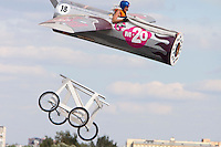 Moscow Russia, 07/08/2011..A contestant and her aircraft fly briefly through the air at Red Bull Flugtag, when some 100,000 people gathered to watch a variety of homemade makeshift aircraft launched over and into the Moscow river.