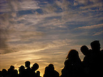 Silhouette of crowd at sunset waiting to see the fireworks on the 4th of July in New York City