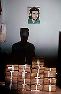 Cuba, March 1992: A portrait of Che Guevara inside the Cohiba factory in Havana. Finished cigars are tied in bundles and are kept for atleast a week in a safe with 18 degrees temp and at 80% humidity.
