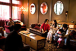 "NAMES CQ: Amy Liu, center, and Michelle Xiao, right, chat on the couch, as Kirk Wang, and daughter Kasey, 3, far right, read a book in the lounge of Avia Napa, along First Street, in downtown Napa, Ca., on Saturday, May 22, 2010. Recent development along First Street includes a new boutique hotel, restaurants, and tasting rooms has helped revitalize Napa's downtown, which has recently been coined the ""West End."""