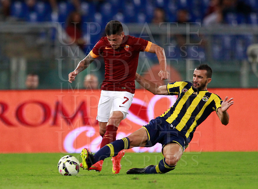 Calcio, amichevole Roma vs Fenerbahce. Roma, stadio Olimpico, 19 agosto 2014.<br /> RRoma forward Juan Iturbe, of Argentina, is tackled by Fenerbache midfielder Mehmet Topal, right, during the friendly match between AS Roma and Fenerbahce at Rome's Olympic stadium, 19 August 2014.<br /> UPDATE IMAGES PRESS/Isabella Bonotto
