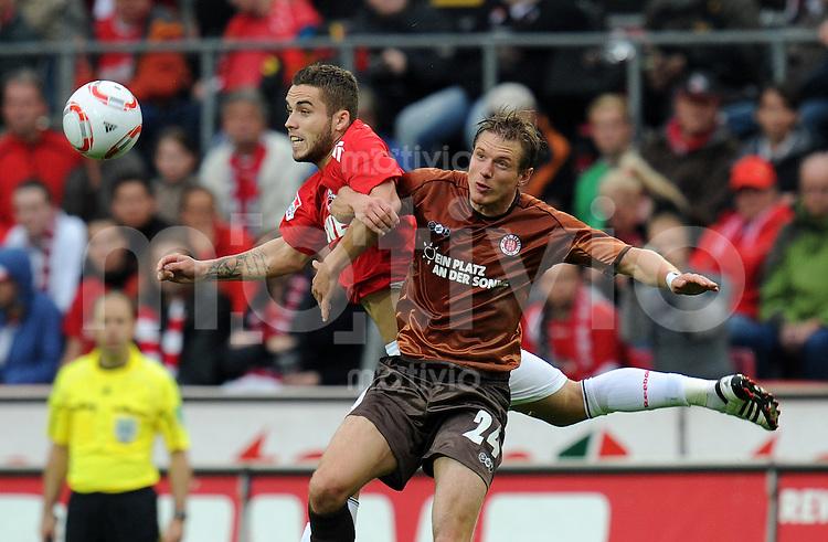 FUSSBALL   1. BUNDESLIGA   SAISON 2010/2011   3. SPIELTAG 1. FC Koeln - FC St. Pauli Hamburg                          12.09.2010 Carsten ROTHENBACH (vorn, St. Pauli) gegen Alexandru IONITA (hinten, Koeln)