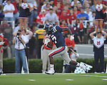 Alabama quarterback AJ McCarron (10) is tackled by Ole Miss' Ralph Williams (44) at Vaught-Hemingway Stadium in Oxford, Miss. on Saturday, October 14, 2011. Alabama won 52-7.