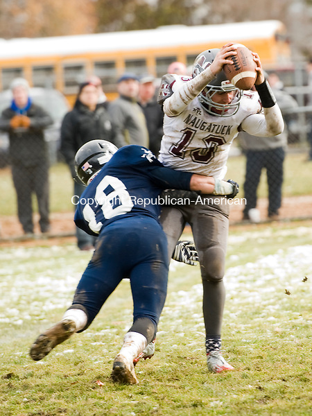 ANSONIA, CT- 27 November 2014-112714EC09--   Naugatuck's Jason Bradley is sacked before the throw Thursday morning by Ansonia's Tyler Doy. The Chargers won the NVL title with a 47-12 win over the Greyhounds. Erin Covey Republican-American