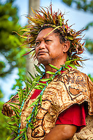 A man in traditional attire participates in Makirau Haurua's investiture with the Teurukura Ariki title, Aitutaki Island, Cook Islands.