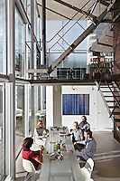 Friends gather for lunch in architect, Hans van Heeswijk's, impressive contemporary house in Amsterdam, where triple-height windows and virtually no walls creates a wonderful sense of space and light.