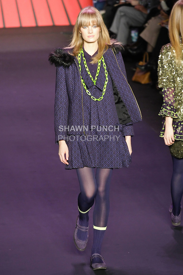 Constance Jablonski walks runway in an outfit from the Anna Sui Fall 2011 collection, during Mercedes-Benz Fashion Week Fall 2011.