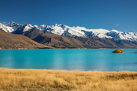 Early snow dusts the hills above Lake Pukaki in this Autumn image.