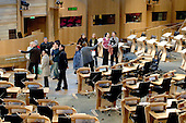Guided tour in the debating Chamber at the new Scottish Parliament building at Holyrood, Edinburgh.  Designed by Spanish architect, Enric Miralles.