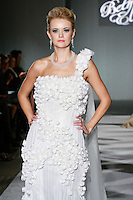 Model walks the runway in a Beth Elis Starlight wedding dress by Nere Emiko during the Wedding Trendspot Spring 2011 Press Fashion, October 17, 2010.