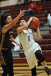Ketchikan's AJ DelaCruz drives against Lathrop's Tyra Do in their Dimond Lady Lynx Prep Shootout basketball game Friday, February 10, 2017.  Photo for the Daily News by Michael Dinneen