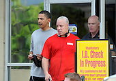 Kailua, Hawaii - December 28, 2008 -- United States President-elect Barack Obama (left) greets well wishers outside the Semper Fit gym after his morning workout in Kailua, Hawaii on Sunday, December 28, 2008. Obama and his family arrived in his native Hawaii December 20 for the Christmas holiday..Credit: Joaquin Siopack - Pool via CNP