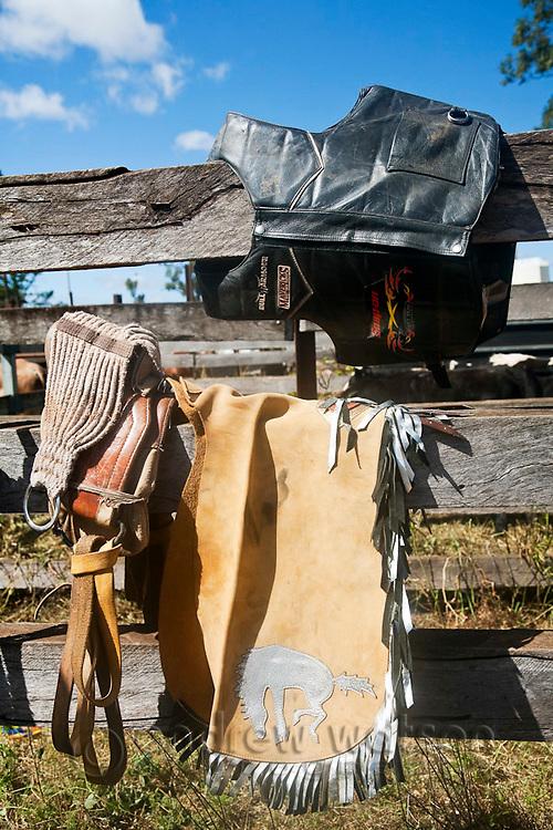 Equipment for a bareback bronc rider - chaps, vest and rigging.  Mt Garnet Rodeo, Mt Garnet, Queensland, Australia