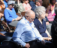 STAFF PHOTO ANDY SHUPE - John and Frances Dockery pause to pray during a dedication ceremony Sunday, Sept. 21, 2014, for the Gehring Cemetery at Christian Life Cathedral in Fayetteville. The Dockerys were caretakers of the cemetery for more than 20 years.