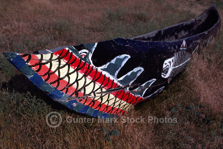 Traditional Painted Native American Indian Dugout Canoe lying on Ground, BC, British Columbia, Canada