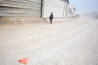 Bedouin boy wait for the school bus in the town of Lakia.   Photo by Oren Nahshon