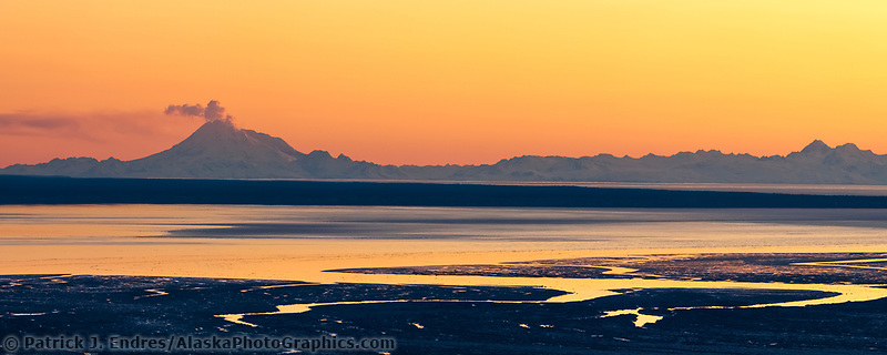 Panorama of plume of gas and vapor vent from the summit of Mt. Redoubt volcano, Chigmit mountains, Aleutian Range, as viewed across the Cook Inlet, southcentral, Alaska.