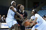 16 December 2014: North Carolina's Danielle Butts (right) strips the ball from Oregon State's Jen'Von'Ta Hill (center) with help from Jamie Cherry (left). The University of North Carolina Tar Heels hosted the Oregon State University Beavers at Carmichael Arena in Chapel Hill, North Carolina in a 2014-15 NCAA Division I Women's Basketball game. Oregon State won the game 70-55.