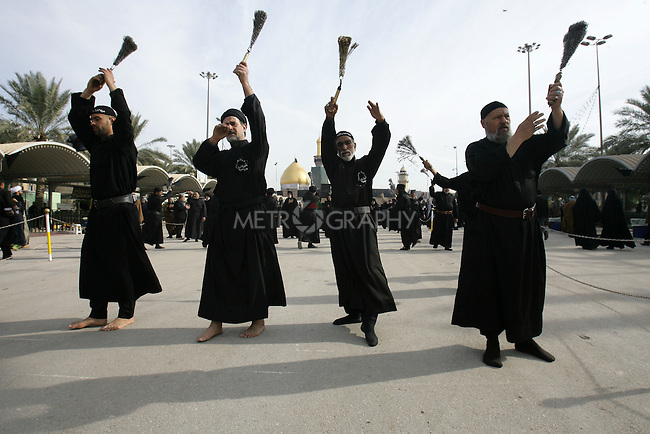 KARBALA, IRAQ: A Shia pilgrims flagellate themselves in mourning...Shia pilgrims pray during the last day of the Ashura festival...Photo by Metrography