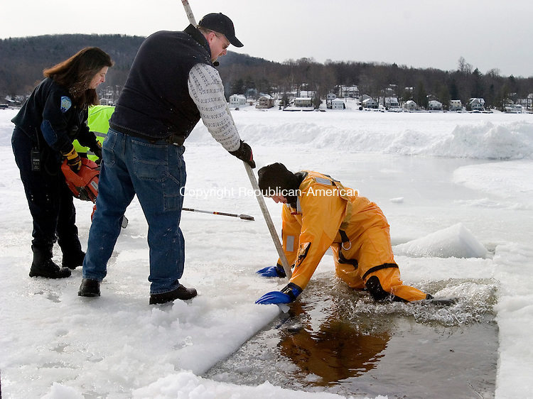 WINSTED, CT 06 February 2008-020609SV04--From left, Lt. Angela Chiofalo, Asst. Chief David Sartirana,  and Firefighter Donovan Brown cut ice and clear a space for sixth annual Highland Lake Penguin Plunge to benefit Special Olympics Connecticut Northwest Region Friday in Winsted. The plunge will be held Saturday.<br /> Steven Valenti Republican-American