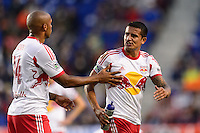 Thierry Henry (14) of the New York Red Bulls tries to calm Tim Cahill (17). The New York Red Bulls defeated FC Dallas 1-0 during a Major League Soccer (MLS) match at Red Bull Arena in Harrison, NJ, on September 22, 2013.