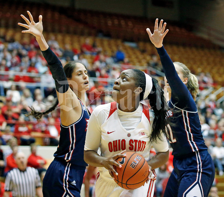 Stephanie Mavunga (1) of the Ohio State Buckeyes looks for an open shot while guarded by Amadea Szamosi (15)  and Kadri-Ann Lass (42) of the Duquesne Lady Dukes during the Buckeyes' home opener at St. John Arena on Friday, November 11, 2016. Ohio State led 46-26 at halftime. (Barbara J. Perenic/The Columbus Dispatch)
