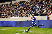 Dax McCarty (13) of FC Dallas takes a corner kick. The New York Red Bulls defeated FC Dallas 2-1 during a Major League Soccer (MLS) match at Red Bull Arena in Harrison, NJ, on April 17, 2010.