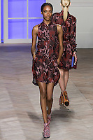 Jourdan Dunn walks the runway in a red camouflage cotton sleeveless safari shirtdress, by Tommy Hilfiger for the Tommy Hilfiger Spring 2012 Pop Prep Collection, during Mercedes-Benz Fashion Week Spring 2012.