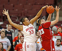 Ohio State Buckeyes center Ashley Adams (33) blocks a shot by Nebraska Cornhuskers forward Emily Cady (23) in second half play at Value City Arena in Columbus, Ohio on February 20,  2014. (Chris Russell/Dispatch Photo)