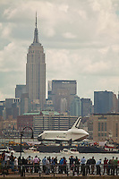 Space Shuttle Enterprise passes next to the Empire State Building on its way up the Hudson River to be placed at the Intrepid Sea, Air and Space Museum in New York, June 6, 2012.  Photo by Eduardo Munoz Alvarez / VIEW..