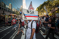 "Protesters in midtown Manhattan in New York demonstrate against the National Security Agency's surveillance of Americans' email and telephone conversations on Sunday, August 4, 2013. The protest was organized by a group called ""Restore the Fourth"" referring to the Fourth Amendment of the Constitution which protects citizens against unreasonable searches by the government. Many citizens are opposed to the NSA activities and the events which took place around the country were called ""1984 Day"".   (© Richard B. Levine)"