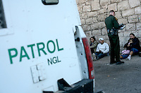 Border Patrol agents arresting a family that just crossed the border..Nogales, AZ.12/9/05.photos: Hector Emanuel