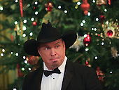 Singer Garth Brooks wait for the beginning of an event for the 2016 Kennedy Center Honorees, in the East Room of the White House, December 4, 2016. The 2016 honorees are: Argentine pianist Martha Argerich; rock band the Eagles; screen and stage actor Al Pacino; gospel and blues singer Mavis Staples; and musician James Taylor.<br /> Credit: Aude Guerrucci / Pool via CNP