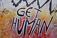 Section of the Berlin Wall depicting a detail of the painting Die Geburt des Kachinas by Jurden Grosse (Indiano), with the words Get Human, damaged by graffiti, part of the East Side Gallery, a 1.3km long section of the Wall on Muhlenstrasse painted in 1990 on its Eastern side by 105 artists from around the world, Berlin, Germany. Picture by Manuel Cohen