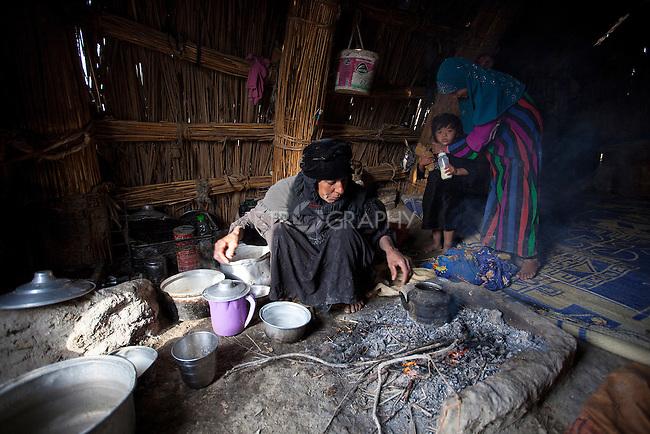 15/12/2015-Chbaish,Iraq-Naeema Alawy, boiling buffalo milk to make cream (Qaimagh).