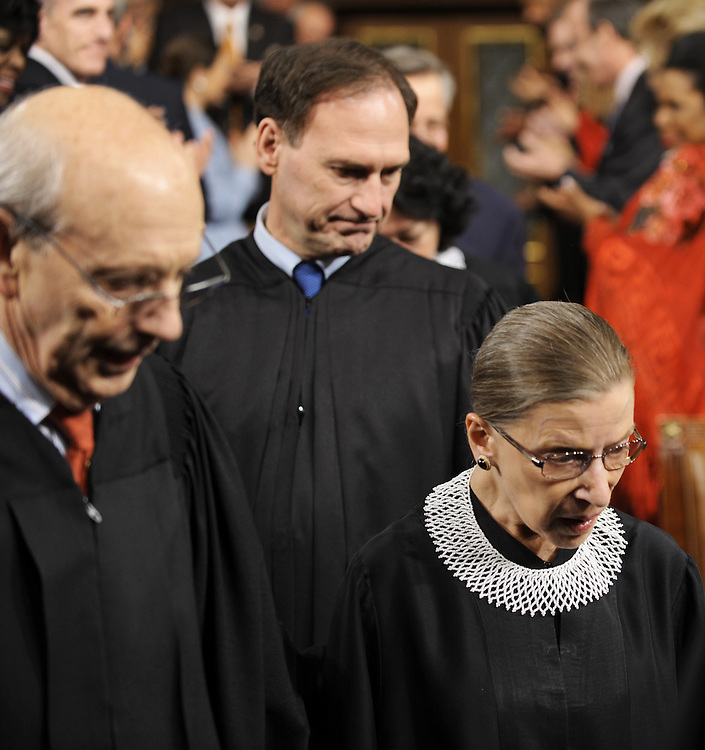 US Supreme Court Justices Stephen Breyer(L) Samuel Alito(C) and Ruth Bader Ginsburg enter the US House of Representatives attending as US President Barack Obama delivers his first State of the Union speech to a joint session of the U.S. Congress January 27, 2010 in Washington.  AFP Photo /Tim Sloan/POOL