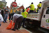 October 28, 2012 (Washington, DC)  D.C. Department of Public Works (DPW) employees distribute sandbags to residents in preparation for Hurricane Sandy  (Photo by Don Baxter/Media Images International)