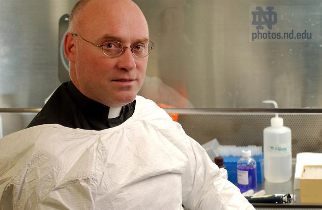 Rev. Tom Streit, C.S.C. in his Galvin Hall lab, 2003...Photo by Matt Cashore.