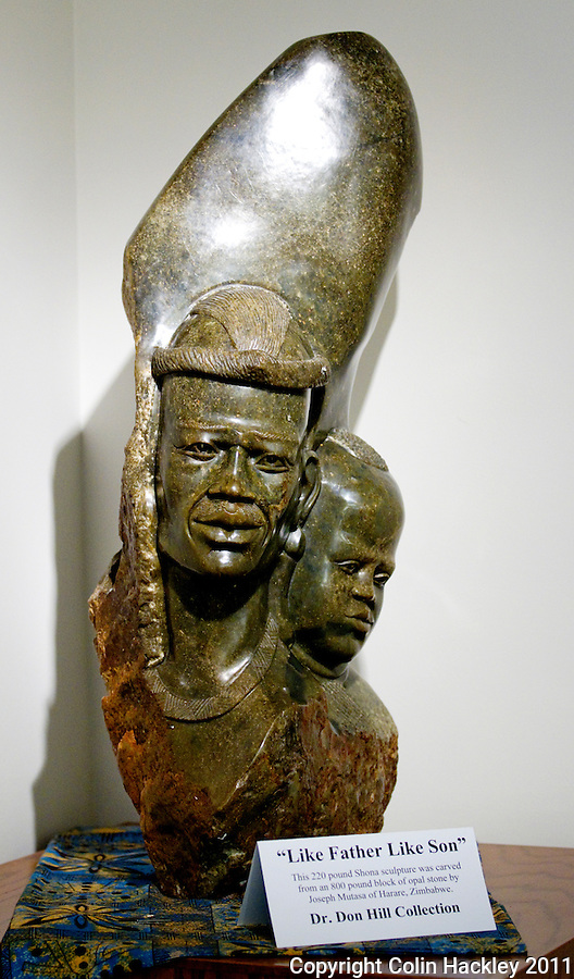 """""""LIKE FATHER LIKE SON:"""" The 220 pound Shona sculpture carved from Opal anchors a corner of Africa Room collection at The Black Archives in Tallahassee..COLIN HACKLEY PHOTO"""