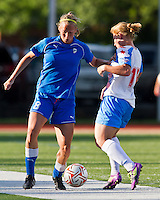 Boston Breakers defender Julie King (8) breaks free from Chicago Red Stars midfielder/forward Lori Chalupny (17) in a tackle.  The Boston Breakers beat the Chicago Red Stars 1-0 at Dilboy Stadium.