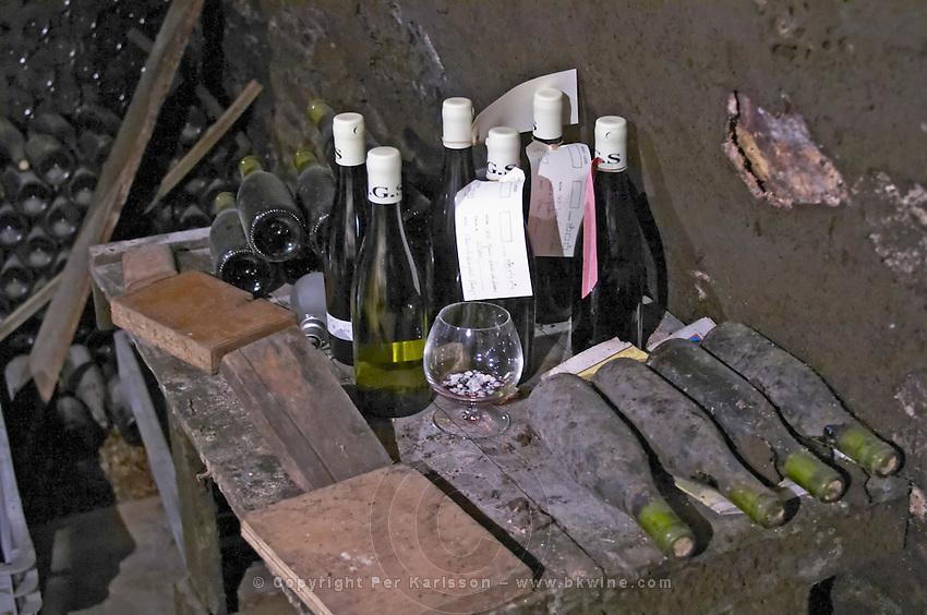 dusty bottles in a corner domaine gros f & s vosne-romanee cote de nuits burgundy france