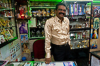 Mr. Moraes in his shop on the corner of Jampettah street. Dressed in his finest shirt on the day of the St. Anthony feast, June 13th 2012.