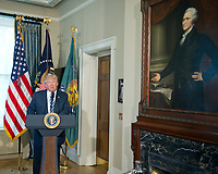 United States President Donald J. Trump makes remarks next to a portrait of Alexander Hamilton, the first US Secretary of the Treasury, prior to signing Executive Orders concerning financial services at the Department of the Treasury in Washington, DC on April 21, 2017.<br /> Credit: Ron Sachs / Pool via CNP /MediaPunch