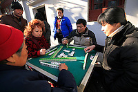 Men and women play mahjong in the street in Shanghai, China, on January 10, 2009. Photo by Lucas Schifres/Pictobank
